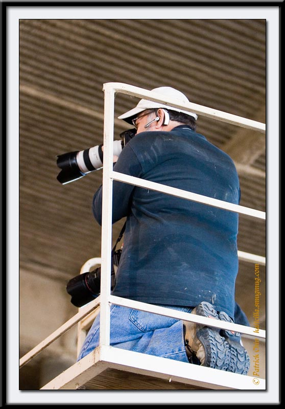 A pro guy with 5D and 20D bodies on a grand-stand shooting area.