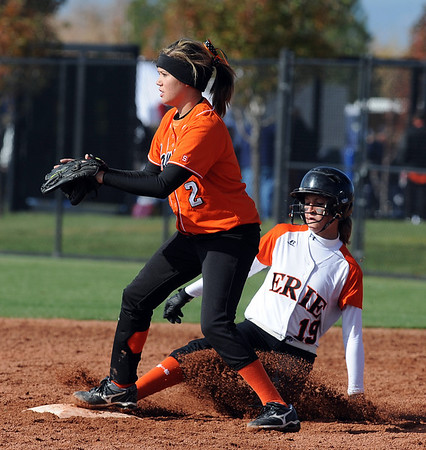 Makayla Kovac, right, of Erie is save before the throw to Chelsea Hall-Chavira of Lamar on Friday.<br /> Cliff Grassmick / October 23, 2009