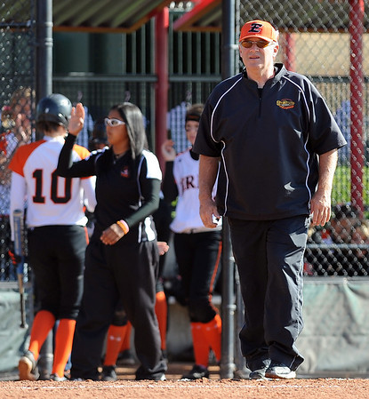 Erie softball coach Bob Bledsoe watches his team play Lamar at State in Aurora.<br /> Cliff Grassmick / October 23, 2009