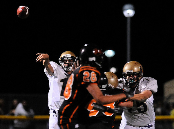 Holy Family High School quarterback Zach Langfield throws a pass on Friday, Sept. 10, during a football game against Erie High School in Erie. Holy Family lost  21-17.<br /> Jeremy Papasso/ The Camera