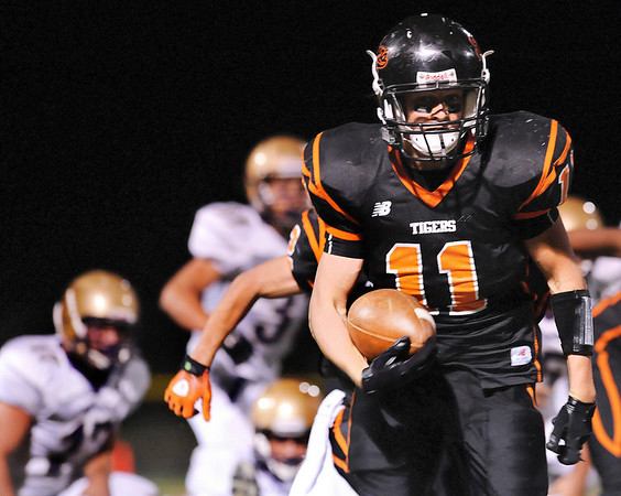 "Erie High School senior Zack Chambers rushes the ball for big yardage on Friday, Sept. 10, in a football game against Holy Family at Erie High School. Erie defeated Holy family 21-17.<br /> For photo gallery go to  <a href=""http://www.dailycamera.com"">http://www.dailycamera.com</a><br /> Jeremy Papasso/ The Camera"