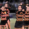 Erie High School cheerleader Mackenzie Lutgens, front right, and the rest of the cheer squad perform for fans on Friday, Sept. 10, during a football game against Holy Family High School in Erie. Erie beat Holy Family 21-17.<br /> Jeremy Papasso/ The Camera