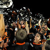 "Erie High School junior Tyler Giulio, right, joins his teams celebration on Friday, Sept. 10, after winning the football game against Holy Family High School 21-17.<br /> For photo gallery go to  <a href=""http://www.dailycamera.com"">http://www.dailycamera.com</a><br /> Jeremy Papasso/ The Camera"