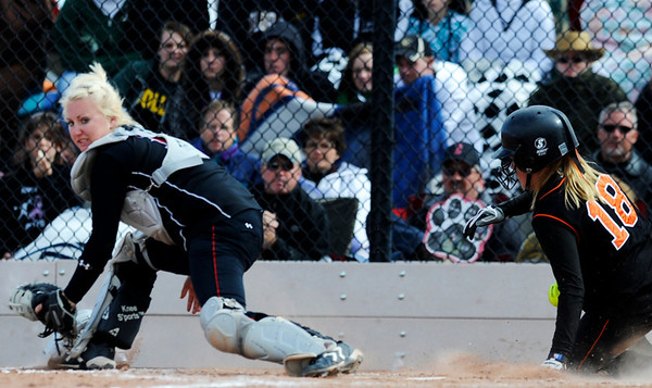 Erie's Kaylnn Harmon (18) brings another run in as Burlington's catcher scrambles for the ball at the Class 3A State Championships at Aurora Sports Park in Aurora Saturday, Oct. 24, 2009. Erie won the championships, 8-0.  <br /> KASIA BROUSSALIAN / THE CAMERA