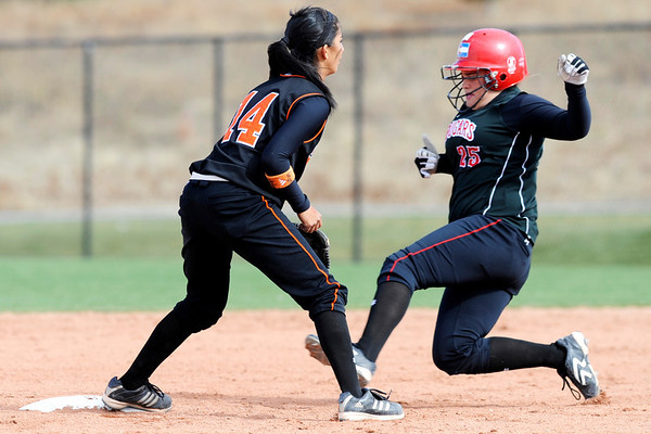 Erie's Jordan Ruiz (14) waits for the ball as Burlington's Mari Satterly (25) slides safely into second at the Class 3A State Championships at Aurora Sports Park in Aurora Saturday, Oct. 24, 2009. Erie won the championships, 8-0.  <br /> KASIA BROUSSALIAN / THE CAMERA
