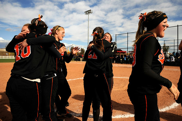 Erie High School's softball team runs onto the field after winning the Class 3A State Championships against Burlington at Aurora Sports Park in Aurora Saturday, Oct. 24, 2009. <br /> KASIA BROUSSALIAN / THE CAMERA