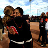 Erie High School's Jordan Ruiz (right) hugs teammate Alexis Gartrell  on the field after winning the Class 3A State Championships against Burlington at Aurora Sports Park in Aurora Saturday, Oct. 24, 2009. <br /> KASIA BROUSSALIAN / THE CAMERA