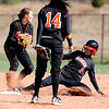 Erie's Haley David (71) turns a double play while teammate Jordan Ruiz (14) stands by, as Burlington's Kelsey Baker (3) gets out at second at the Class 3A State Championships at Aurora Sports Park in Aurora Saturday, Oct. 24, 2009. Erie won the championships, 8-0.  <br /> KASIA BROUSSALIAN / THE CAMERA