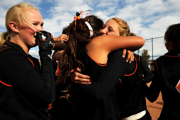Erie High School's softball team, including Makayla Kovac (middle right) and Claire Nibbe (far left) celebrate on the field after winning the Class 3A State Championships against Burlington at Aurora Sports Park in Aurora Saturday, Oct. 24, 2009. <br /> KASIA BROUSSALIAN / THE CAMERA