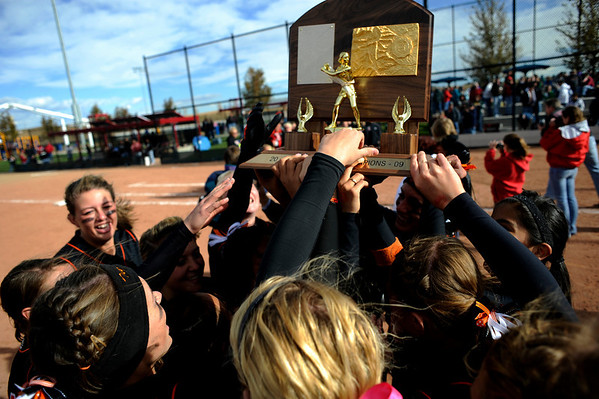 Erie High School's softball team hoists the trophy on the field after winning the Class 3A State Championships against Burlington at Aurora Sports Park in Aurora Saturday, Oct. 24, 2009. <br /> KASIA BROUSSALIAN / THE CAMERA