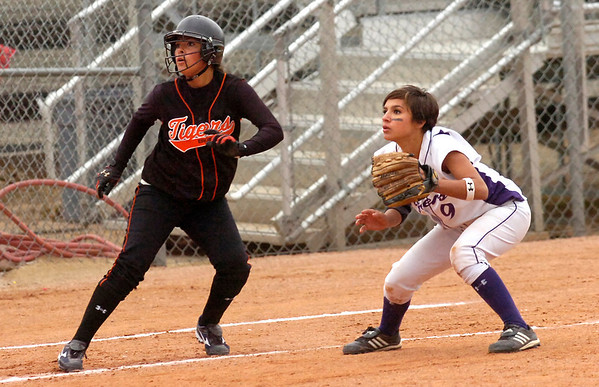 Sasha Duran-Fong, running the bases for Erie High and infielder Angelina Sierra-Sandoval of Holy Family High watch a hit during the fifth inning of their game at Erie HS on Tuesday  September 22, 2009.<br /> Photo by Paul Aiken