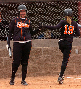 Brittany Maul, at left congratulates Makayla Kovac after Kovac scored during a big fifth inning for Erie High School as they played Holy Family at Erie HS on Tuesday  September 22, 2009. Photo by Paul Aiken