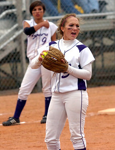 Pitcher Rachel Boothe of Holy Family encourages teammates during a tough fifth inning against  Erie High School. They played at Erie HS on Tuesday  September 22, 2009. Photo by Paul Aiken
