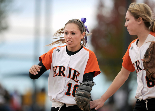 "Erie High School's Sonoma Toot, left, gets a high-five from teammate Amanda Ochoa after making the third out of the fifth inning during a game against Wheat Ridge High School on Saturday, Oct. 20, at the Aurora Sports Park in Aurora. Erie Lost the game 6-4. For more photos of the game go to  <a href=""http://www.dailycamera.com"">http://www.dailycamera.com</a><br /> Jeremy Papasso/ Camera"