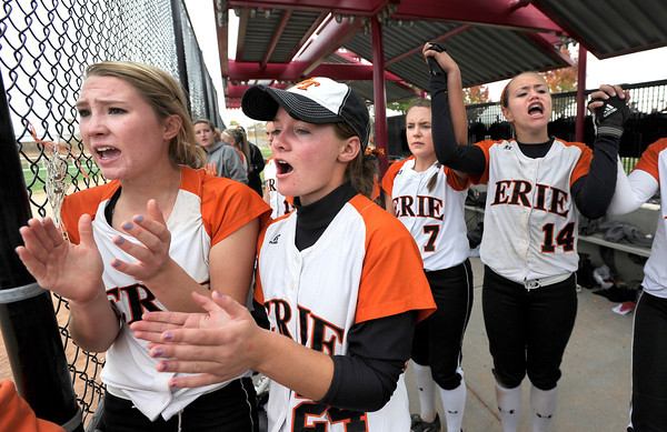 "Erie High School's Amanda Ochoa, left, Kenzie Kudrna Carrie Clarke and Rachel Natal try to get their team pumped up in the seventh inning during a game against Pueblo East High School on Saturday, Oct. 20, at the Aurora Sports Park in Aurora. Erie Lost the game 6-4. For more photos of the game go to  <a href=""http://www.dailycamera.com"">http://www.dailycamera.com</a><br /> Jeremy Papasso/ Camera"