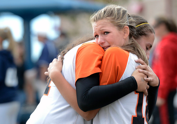 "Erie High School's Claire Nibbe, right, shows her emotions as she hugs teammate Tiffany Maul after losing a state semifinal game against Pueblo East High School on Saturday, Oct. 20, at the Aurora Sports Park in Aurora. Erie lost the game 6-4. For more photos of the game go to  <a href=""http://www.dailycamera.com"">http://www.dailycamera.com</a><br /> Jeremy Papasso/ Camera"