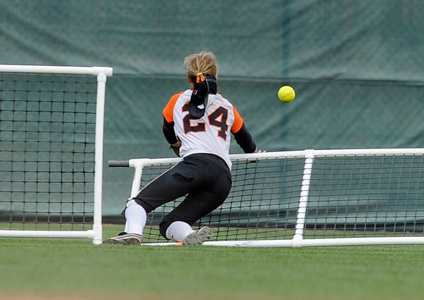 """Erie High School's Kenzie Kudrna takes down the fence while trying to catch a deep hit during a game against Pueblo East High School on Saturday, Oct. 20, at the Aurora Sports Park in Aurora. The play resulted in a Wheat Ridge home run. Erie Lost the game 6-4. For more photos of the game go to  <a href=""""http://www.dailycamera.com"""">http://www.dailycamera.com</a><br /> Jeremy Papasso/ Camera"""