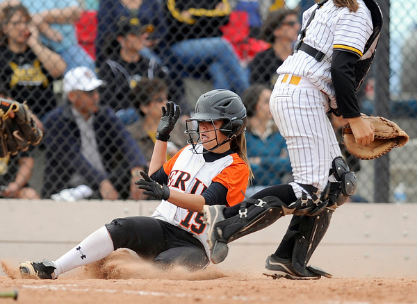 """Erie High School's Kaitlyn Glaze slides into home plate safely under catcher Mary Sand during a game against Pueblo East High School on Saturday, Oct. 20, at the Aurora Sports Park in Aurora. Erie Lost the game 6-4. For more photos of the game go to  <a href=""""http://www.dailycamera.com"""">http://www.dailycamera.com</a><br /> Jeremy Papasso/ Camera"""