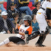 "Erie High School's Kaitlyn Glaze slides into home plate safely under catcher Mary Sand during a game against Pueblo East High School on Saturday, Oct. 20, at the Aurora Sports Park in Aurora. Erie Lost the game 6-4. For more photos of the game go to  <a href=""http://www.dailycamera.com"">http://www.dailycamera.com</a><br /> Jeremy Papasso/ Camera"
