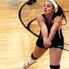 KEN YUSZKUS/Staff photo. Essex Tech's Dianna LeBlanc sends the ball back over the net during the Shawsheen at Essex Tech girls volleyball game. 9/22/14