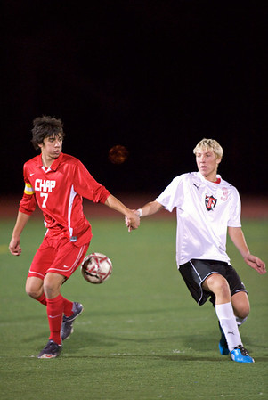 S1104SOCCER3.jpg S1104SOCCER3<br />  Fairview's # 3, Matt Bohunek and Chaparral # 7, Sam Perez get tangled in the midfield.<br /> <br /> Photo by: Jonathan Castner