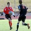 Fairview High School's Bryan Windsor settles the ball while #8 Josh Murdock defends  during their game against Grand Junction High School on Wednesday October 27, 2010 in Boulder.<br /> Photo by Paul Aiken