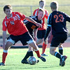 Fairview High Schools #10 Shane O'Neill works against #23 Talon Bates and #10 Sean Foster during their game against Grand Junction High School on Wednesday October 27, 2010 in Boulder.<br /> Photo by Paul Aiken