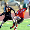 Fairview High School's #21 Peyton Schiefele moves around #23 Talon Bates  during their game against Grand Junction High School on Wednesday October 27, 2010 in Boulder.<br /> Photo by Paul Aiken