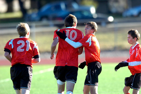 Fairview High School's #10 Shane O'Neill is congratulated by #5 Soren Frykholm after O'Neill scored a goal  during their game against Grand Junction High School on Wednesday October 27, 2010 in Boulder.<br /> Photo by Paul Aiken