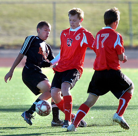 Fairview High School's #6 Jared Davis tackles the ball from #15 Igor Chernenko  during their game against Grand Junction High School on Wednesday October 27, 2010 in Boulder.<br /> Photo by Paul Aiken