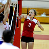 "Fairview High School's Ciel Tift spikes the ball into the teeth of the defense in their match against Cherry Creek High School on September 6, 2011. FOR MORE PHOTOS GO TO  <a href=""http://WWW.DAILYCAMERA.COM"">http://WWW.DAILYCAMERA.COM</a><br /> Photo by Paul Aiken / The Camera / September 6 2011"