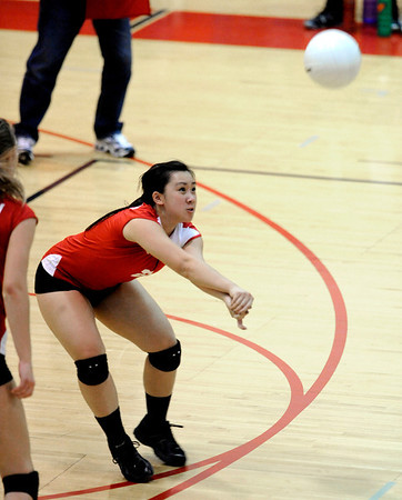 "Fairview High School's Stephanie Lee #2 makes a dig in their match against Cherry Creek High School on September 6, 2011. FOR MORE PHOTOS GO TO  <a href=""http://WWW.DAILYCAMERA.COM"">http://WWW.DAILYCAMERA.COM</a><br /> Photo by Paul Aiken / The Camera / September 6 2011"