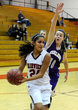 "Fairview High School's Sonia Ghosh drives to the hoop past Ashley Evans during a game against Fort Collins High School on Friday, Jan. 27, at Fairview High School in Boulder. Fairview won the game 45-39. For more photos of the game go to  <a href=""http://www.dailycamera.com"">http://www.dailycamera.com</a><br />  Jeremy Papasso/ Camera"