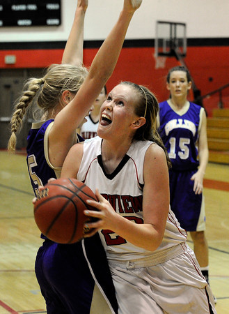 """Fairview High School's Hannah Hyde takes a shot over Nicole Lange during a game against Fort Collins High School on Friday, Jan. 27, at Fairview High School in Boulder. Fairview won the game 45-39. For more photos of the game go to  <a href=""""http://www.dailycamera.com"""">http://www.dailycamera.com</a><br />  Jeremy Papasso/ Camera"""