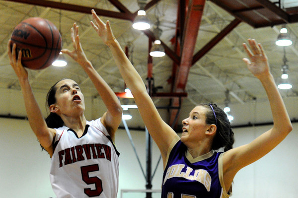 "Fairview High School's Annika Lai takes a shot over Kasey Dietrich during a game against Fort Collins High School on Friday, Jan. 27, at Fairview High School in Boulder. Fairview won the game 45-39. For more photos of the game go to  <a href=""http://www.dailycamera.com"">http://www.dailycamera.com</a><br />  Jeremy Papasso/ Camera"