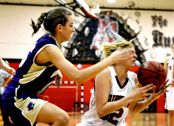 Fairviews Georginia Ryder, 32, at right battles for the ball with  Fort Collins Kasey Dietrich, 15, during their game at Fairview High School on Friday January 27, 2012.<br /> Photos by Fabian Matzerath