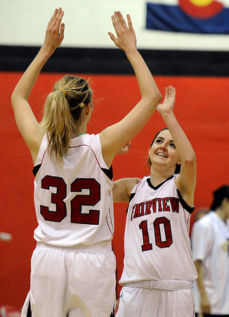 """Fairview High School's Georgina Ryder, No. 32, and Meghan Higgins high-five each other after defeating Fort Collins High School 45-39 on Friday, Jan. 27, at Fairview High School in Boulder. For more photos of the game go to  <a href=""""http://www.dailycamera.com"""">http://www.dailycamera.com</a><br />  Jeremy Papasso/ Camera"""