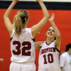 "Fairview High School's Georgina Ryder, No. 32, and Meghan Higgins high-five each other after defeating Fort Collins High School 45-39 on Friday, Jan. 27, at Fairview High School in Boulder. For more photos of the game go to  <a href=""http://www.dailycamera.com"">http://www.dailycamera.com</a><br />  Jeremy Papasso/ Camera"