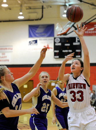 "Fairview High School's Sarah Kaufman takes a shot over Katy Couperus, left, during a game against Fort Collins High School on Friday, Jan. 27, at Fairview High School in Boulder. Fairview won the game 45-39. For more photos of the game go to  <a href=""http://www.dailycamera.com"">http://www.dailycamera.com</a><br />  Jeremy Papasso/ Camera"