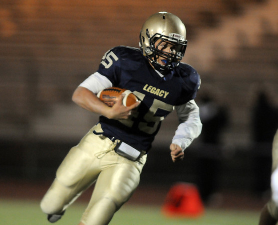 be1011legacyfootball.jpg BE1011FOO03<br /> <br /> Colton Chavez, Legacy starts his run to score a touchdown against Fairview during Friday's game at 5 Star Stadium in Thornton.<br /> <br /> October 9, 2009<br /> Staff photo/David R. Jennings