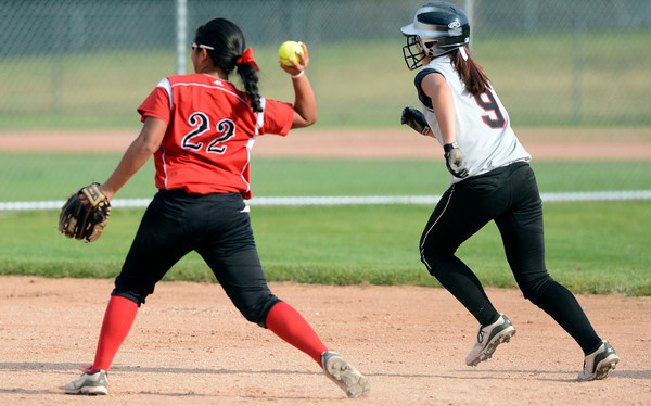 Fairview High's Haley Todacheene (22) readies to throw out Jessica Zanon (9) for a force out at third during the girls softball game between Pomona High at Fairview High School on Tuesday April 21, 2012.<br /> For more photos go to www. bocopreps.com<br /> Photo by Paul Aiken / The Boulder Camera