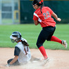Fairview High's Haley Todacheene (22) avoids  a sliding Tori Randolph (14) after a forceout at second during the girls softball game between Pomona High at Fairview High School on Tuesday April 21, 2012.<br /> For more photos go to www. bocopreps.com<br /> Photo by Paul Aiken / The Boulder Camera