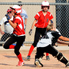Fairview High's Teresa Prinster (8) crosses home plate past catcher Ashley Espinoza as her teammate Jayden Slater (21) cheers her on during a two run scoring double during the girls softball game between Pomona High at Fairview High School on Tuesday April 21, 2012.<br /> For more photos go to www. bocopreps.com<br /> Photo by Paul Aiken / The Boulder Camera