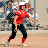 Fairview High's Josie Russell (33) watches her two-run RBI double leave the infield during the girls softball game between Pomona High at Fairview High School on Tuesday April 21, 2012.<br /> For more photos go to www. bocopreps.com<br /> Photo by Paul Aiken / The Boulder Camera