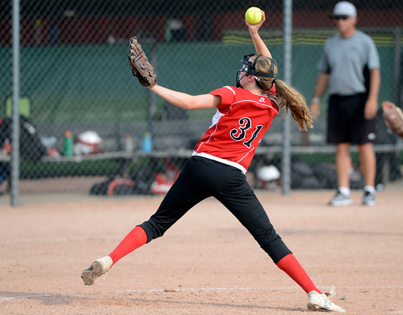Fairview High's Julia McCue(31) throws a pitch during the girls softball game between Pomona High at Fairview High School on Tuesday April 21, 2012.<br /> For more photos go to www. bocopreps.com<br /> Photo by Paul Aiken / The Boulder Camera