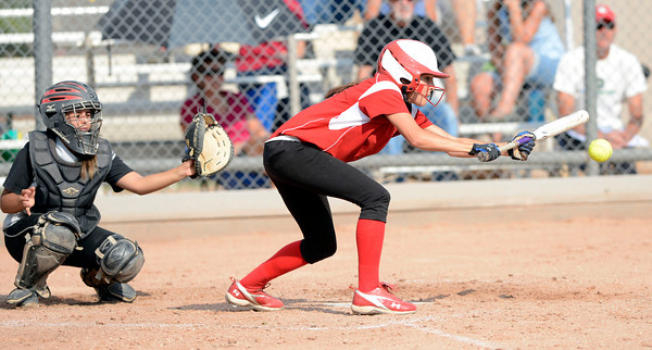 Fairview High's Teresa Prinster (8) puts down a bunt during the girls softball game between Pomona High at Fairview High School on Tuesday April 21, 2012.<br /> For more photos go to www. bocopreps.com<br /> Photo by Paul Aiken / The Boulder Camera