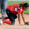 Fairview High's Haley Todacheene (22) makes a hard stop on a ground ball during the girls softball game between Pomona High at Fairview High School on Tuesday April 21, 2012.<br /> For more photos go to www. bocopreps.com<br /> Photo by Paul Aiken / The Boulder Camera