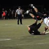 CARL RUSSO/Staff photo. Andover defeated North Andover 33-32 in overtime football action Friday night. Andover's Kevin Chen breaks up the pass intended for North Andover's Tyler Salois. 9/6/2013.