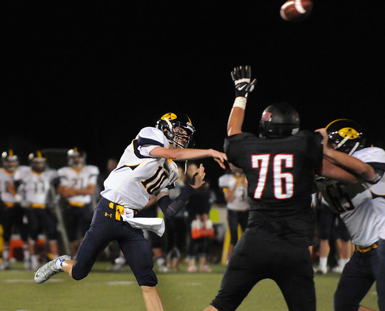 CARL RUSSO/Staff photo. Andover defeated North Andover 33-32 in overtime football action Friday night. Andover's quarterback, Oliver Eberth throws long.   9/6/2013.