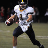 CARL RUSSO/Staff photo. Andover defeated North Andover 33-32 in overtime football action Friday night. Andover's Christopher Nicholas looks for running room. 9/6/2013.
